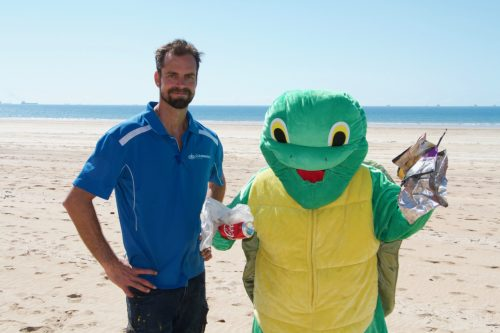 Aaron Horsey and the Reef Catchments mascot, Theo the Turtle.